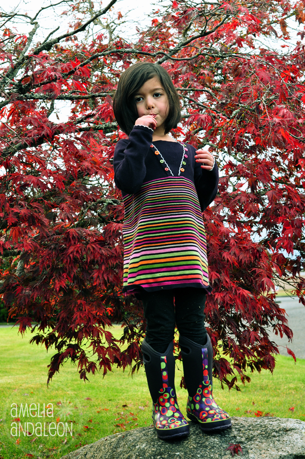 Nora - lollipop, boots and neighbor's maple tree